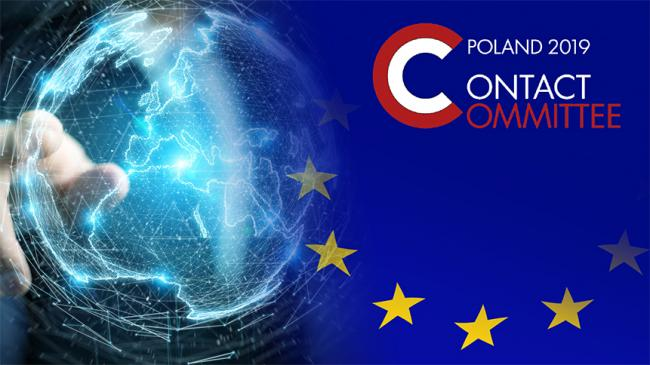 Logo of Contact Committee Poland 2019 in the background person pointing at the globe and part of EU flag