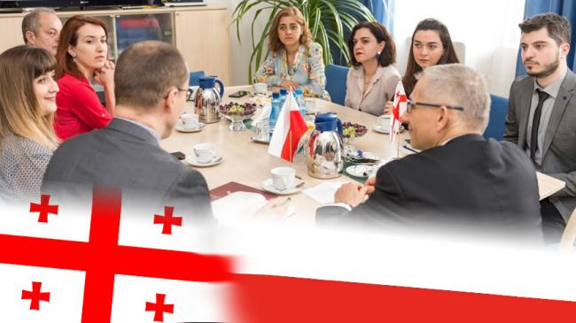Georgian delegation at NIK, flags of Georgia and Poland