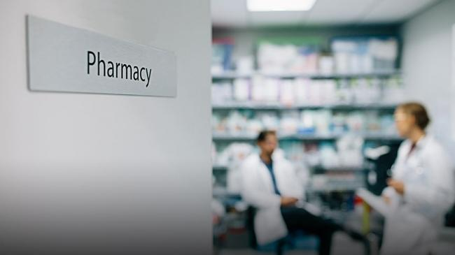 A pharmacy with two pharmacists inside