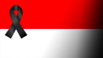 Indonesia flag with black ribbon
