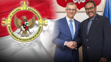 President of NIK, Krzysztof Kwiatkowski with Vice-Chairman of the Audit Board of the Republic of Indonesia (BPK), Barullah Akbar next to flag of the Republic of Indonesia and logo of Audit Board of the Republic of Indonesia